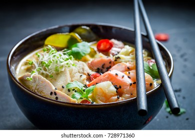 Yummy Malaysian Soup with chicken and shrimps