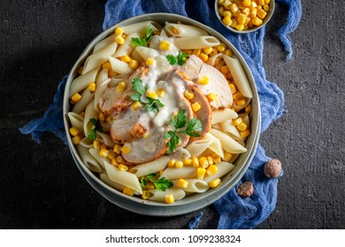 Yummy penne with chicken, corn and bechamel sauce