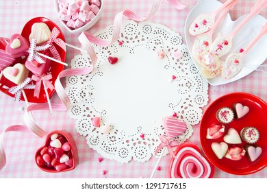 Yummy sweets and chocolates in a heart shape and pink