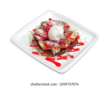 Yummy waffles with ice cream, strawberries syrup on white background, top view