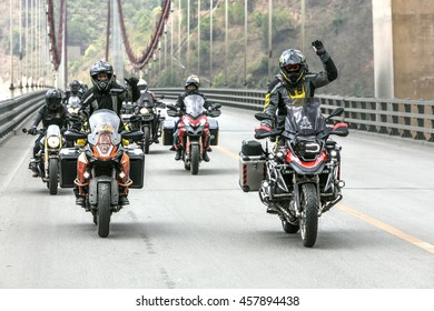 Yunan, China - April 12, 2016: Motorcyclist on the BMW R1200 GS motorcycle driving on the highway in China