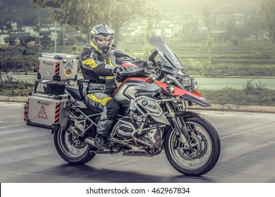 Yunan, China - April 12, 2016: During the summer months of April.Motorcyclist on the BMW R1200 GS motorcycle driving on the highway in China