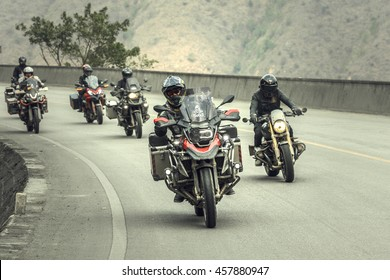 Yunan, China - April 16, 2016: Motorcyclist on the BMW R1200 GS motorcycle driving on the highway in China