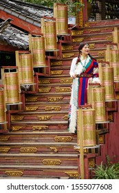 Yunan/china_31 oct 2019: a beautiful lady in traditional Tibetan costume shooting at the staircase of a restaurant.