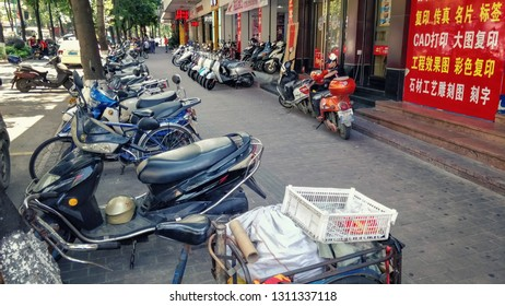 Yunfu city, Guangdong province, China-May 20, 2018: The motor scooter shop with rows of choppers is in an adjacent street to the city bus terminal.