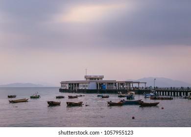 Yung Shue Wan, Lamma Island, Hong Kong, 03/24/2018 : Lamma Island Pier at sunset