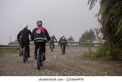 Yungas Road, Bolivia, February 2018: bikers on the 'Death Road' due to its notoriously high death rate, was cut into the side of the Cordillera Oriental Mountain chain in the 1930s.