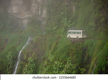 Yungas Road, also known as 'Death Road' due to its notoriously high death rate, was cut into the side of the Cordillera Oriental Mountain chain in the 1930s with dense fog and bus passing a waterfall