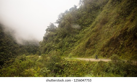 Yungas Road, also known as 'Death Road' due to its notoriously high death rate, was cut into the side of the Cordillera Oriental Mountain chain in the 1930s with dense fog and bike passing