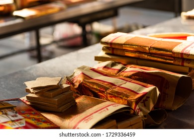 Yunlin, Taiwan - July 13th, 2019: chinese joss gold paper craft on a table at Beigang Chaotian Temple, Yunlin, Taiwan, Asia
