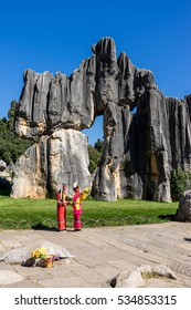 Yunnan China, 22 Nov 2016: Yunnan minority in front of the stone forest