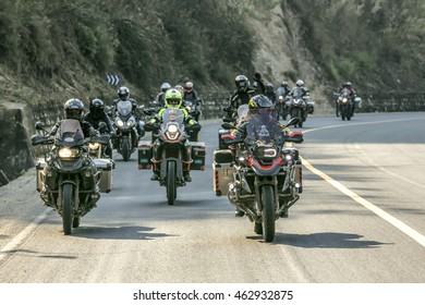 Yunnan, China - April 12, 2016: A motorcyclist on a motorcycle BMW R1200 GS F800 GS and BMW RT are traveling as a group in China.