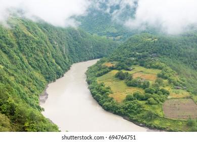 YUNNAN, CHINA - Aug 31 2016: First bend of Nu river in Bingzhongluo Tibetan village. Three Parallel Rivers of Yunnan Protected Areas(World Heritage) in Gongshan, Nujiang, Yunnan, China.