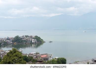 YUNNAN, CHINA - Sep 23 2016: Erhai Lake view from Shuanglang ancient village. a famous historical site in Dali, Yunnan, China.