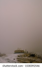 Yurt in the misty mountains after the first snow