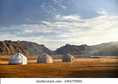Yurt nomadic houses camp at mountain valley in Central Asia