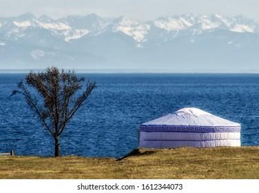 Yurt is a traditional Buryat and Mongolian dwelling. On the shore of Lake Baikal. Siberia, Russia.