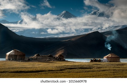 The yurt village in front of Karakul Lake in Xinjiang Uighur Autonomous Region of China is the highest lake of the Pamir plateau, with Muztagh Ata peak of the Kunlun mountains, in the background.
