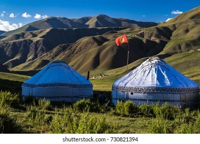Yurts in Kyrgyzstan. Evening near lake..
