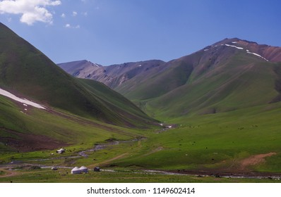 Yurts and mountains near the Chychkan  River,  before Suusamyr Valley  and  the Too-Ashuu Pass, the Osh-Bishkek