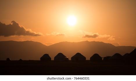 Yurts at sunset, Song-Kol lake, Kyrgyzstan, Central Asia