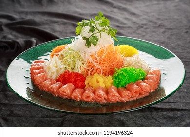 Yusheng, yee sang or yuu sahng usually consists of strips of raw fish (sometimes salmon), mixed with shredded vegetables and a variety of sauces and condiments, among other ingredients.