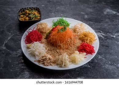Yusheng, yee sang or yuu sahng, or Prosperity Toss is a Cantonese-style raw fish salad. It consists of strips of raw fish, mixed with shredded vegetables and a variety of sauces and condiments.