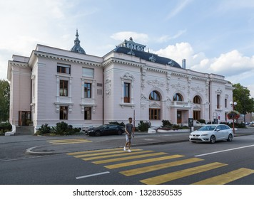 Yverdon-les-Bains, Switzerland - 5.Sept. 2018: Theater building is illuminated by sunlight and there are approaching clouds in the sky. the inscription Theater Benno Besson on the facade is seen - Im