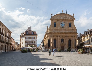 Yverdon-les-Bains, Switzerland - 5.Sept.2018: Protestant Church rises above Pestalozzi square on which outdoor restaurant is visible. It all is seen in the old town - Image