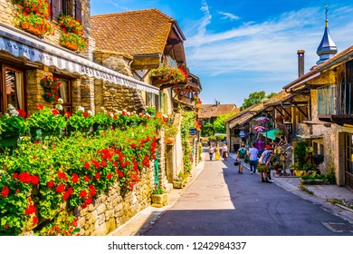 YVOIRE, France, JULY 21, 2017: People are strolling through medieval heart of french town Yvoire