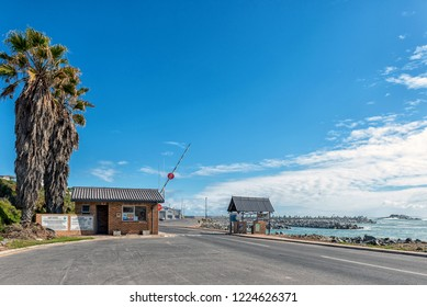 YZERFONTEIN, SOUTH AFRICA, AUGUST 20, 2018: Entrance to the harbor in Yzerfontein on the Atlantic Ocean coast in the Western Cape Province