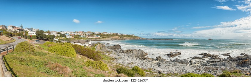 YZERFONTEIN, SOUTH AFRICA, AUGUST 20, 2018: A panoramic coastal scene in Yzerfontein on the Atlantic Ocean coast in the Western Cape Province. Buildings are visible