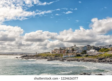 YZERFONTEIN, SOUTH AFRICA, AUGUST 20, 2018: A coastal scene in Yzerfontein on the Atlantic Ocean coast in the Western Cape Province. Houses are visible