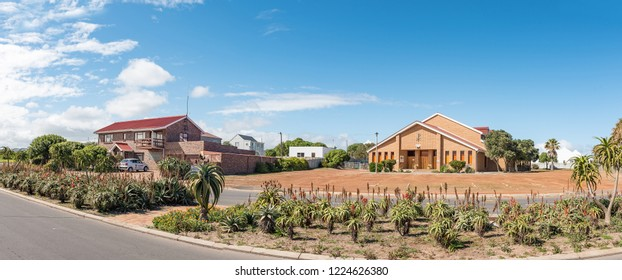 YZERFONTEIN, SOUTH AFRICA, AUGUST 20, 2018: A panoramic street scene, with a house and the Dutch Reformed Church, in Yzerfontein on the Atlantic Ocean coast in the Western Cape Province