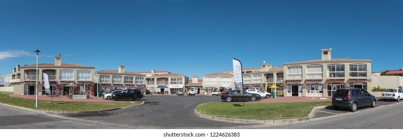 YZERFONTEIN, SOUTH AFRICA, AUGUST 20, 2018: A shopping centre, with businesses and vehicles, in Yzerfontein on the Atlantic Ocean coast in the Western Cape Province