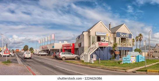 YZERFONTEIN, SOUTH AFRICA, AUGUST 20, 2018: A street scene, with businesses and vehicles, in Yzerfontein on the Atlantic Ocean coast in the Western Cape Province
