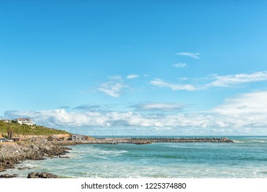 YZERFONTEIN, SOUTH AFRICA, AUGUST 20, 2018: A coastal scene in Yzerfontein on the Atlantic Ocean coast in the Western Cape Province. The harbor is visible