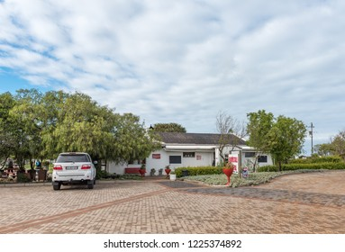 YZERFONTEIN, SOUTH AFRICA, AUGUST 20, 2018: A road stall and winery next to road R27 near Yzerfontein on the Atlantic Ocean coast in the Western Cape Province. A vehicle is visible