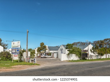 YZERFONTEIN, SOUTH AFRICA, AUGUST 20, 2018: Die Stal Pub and Grill in Yzerfontein on the Atlantic Ocean coast in the Western Cape Province. Vehicles are visible
