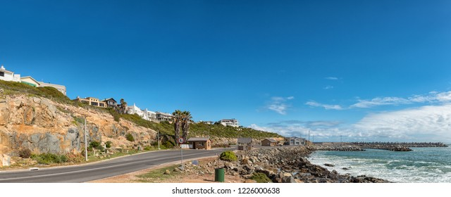 YZERFONTEIN, SOUTH AFRICA, AUGUST 20, 2018: A panoramic coastal scene in Yzerfontein on the Atlantic Ocean coast in the Western Cape Province. The harbor is visible