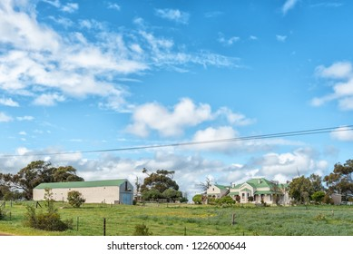 YZERFONTEIN, SOUTH AFRICA, AUGUST 20, 2018: A farm scene on road R315 near Yzerfontein on the Atlantic Ocean coast in the Western Cape Province. A house and a barn is visible