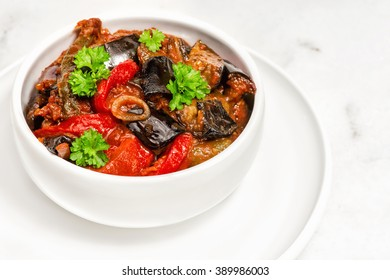 Zaalouk - Moroccan Eggplant Salad. traditional eggplant salad from morocco served on ceramic bowl. Bulgarian national dish made from roasted eggplant , garlic, peppers and spices. Vegetable caviar