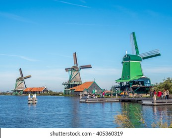 ZAAN SCHANS - OCTOBER 2: View of four historic classic windmills in rural small town named Zaan Schans, Netherlands, under clear blue sky, on October 2, 2015.
