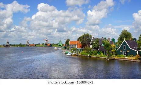 ZAANDAM, Holland - JULY 30: Typical Dutch houses. Zaanse Schans is a museum village with dutch houses and wind mills. In most of the mills still live people; July 30, 2012 in Zaandam, Holland