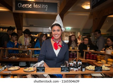 ZAANDAM - JULY 28: Dutch woman selling Dutch Gouda cheese in a shop at the Zaanse Schans on 28 June, 2018 in the Netherlands. Dutch Gouda cheese is Holland's most famous export product.