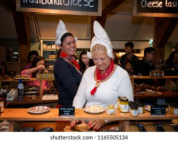 ZAANDAM - JULY 28: Dutch women selling Dutch Gouda cheese in a shop at the Zaanse Schans on 28 June, 2018 in the Netherlands. Dutch Gouda cheese is Holland's most famous export product.