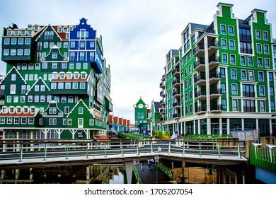 ZAANDAM, NETHERLANDS - AUGUST 18, 2019 :: Unique green color and unique design building in Zaandam area. A shopping street near Amsterdam.