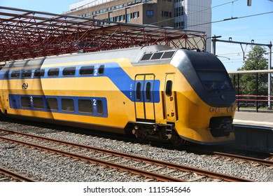 ZAANDAM, NETHERLANDS - JULY 9, 2017: Nederlandse Spoorwegen (NS) train in Zaandam. NS is the principal Dutch public railway company, operating 4,800 domestic trains daily.