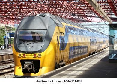 ZAANDAM, NETHERLANDS - JULY 9, 2017: Nederlandse Spoorwegen (NS) train in Zaandam. NS is the principal Dutch public railway company, operating 4,800 domestic trains daily.