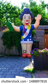 Zaandam, The Netherlands-24th August 2019. Traditional 50th birthday celebration with large inflatable female figure of Sarah at garden gate.